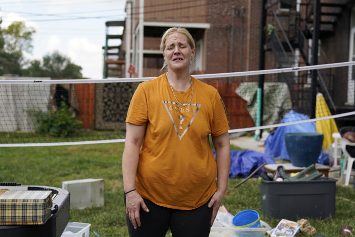 Kristen Bigogno cries as she stands amongst her belongings while being evicted from her home Friday, Sept. 17, 2021, in St. Louis. Bigogno is among thousands of Americans facing eviction now that the national moratorium has ended. (AP Photo/Jeff Roberson)