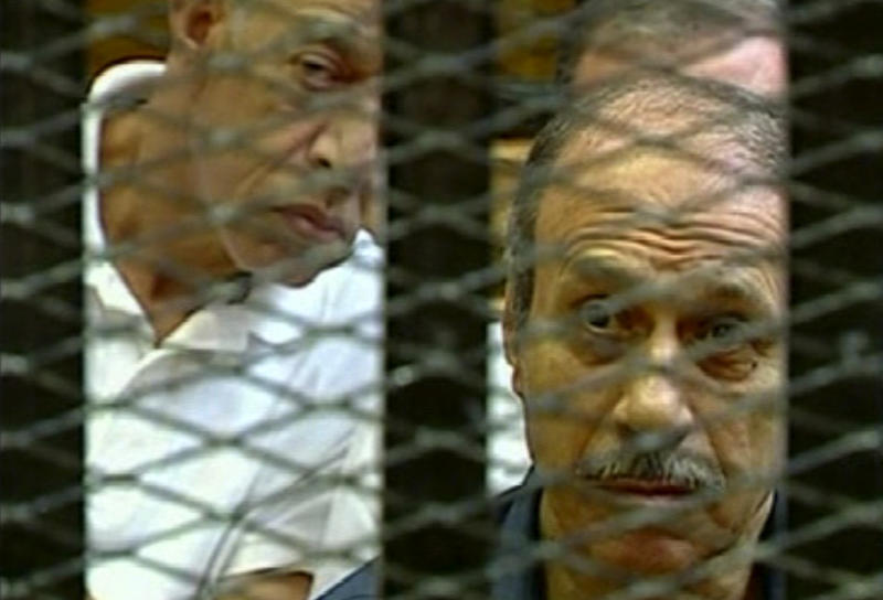 This video image taken from Egyptian State Television shows former Egyptian Interior Minister Habib el-Adly, right, in a cage of mesh and iron bars during his trial in a Cairo courtroom Thursday Aug. 4, 2011. The trial of Hosni Mubarak's security chief Habib el-Adly and six top police officers charged with ordering the use of deadly force against protesters during this year's uprising in Egypt has resumed. Habib el-Adly, six senior police officers and ousted President Hosni Mubarak could be sentenced to death if convicted of ordering protesters killed during the uprising that toppled the longtime president on Feb. 11, 2011.   (AP Photo/Egyptian State TV)   EGYPT OUT
