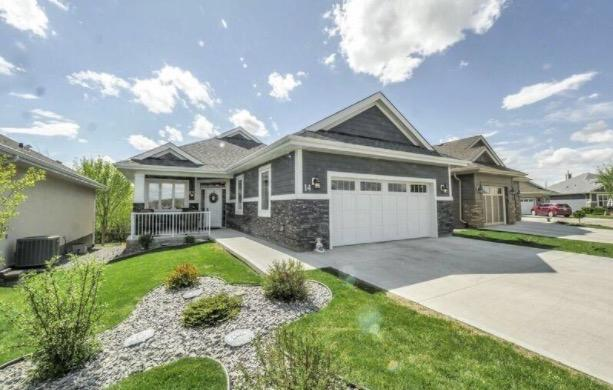 "<p>The first property is <a rel=""nofollow"" href=""https://www.zoocasa.com/search?listing-id=4564265"">18343 Lessard Rd. Northwest</a> in Edmonton. It's being offered for $939,900. </p>"