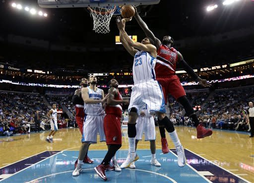 Portland Trail Blazers center J.J. Hickson (21) tries to block a shot by New Orleans Hornets forward Anthony Davis (23) in the first half of an NBA basketball game in New Orleans, Sunday, March 10, 2013. (AP Photo/Gerald Herbert)