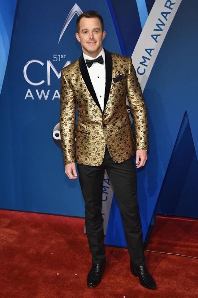 <p>It's not the first time Corbin's been all about the jacket. At the 51st annual ACMAs, the singer wore a pink lamé suit jacket. (Photo: Getty Images) </p>
