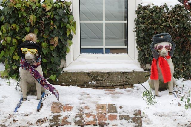 Ornamental dogs dressed for the snow in Minster, Kent