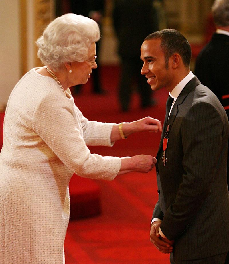 Lewis Hamilton receiving an MBE from the Queen in 2009 [Photo: PA]
