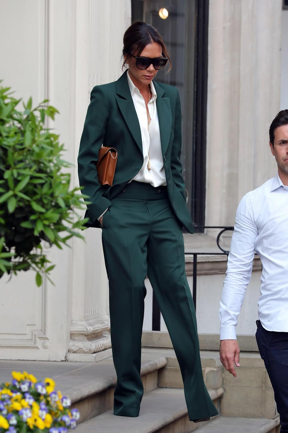 <p>VB looked her usually chic self wearing a forest green suit with a white shirt, photographed for the first time since the royal wedding. <em>[Photo: Getty]</em> </p>