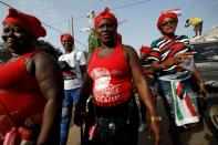 Supporters of the opposition National Democratic Congress partake in an organized community health walk ahead of the December 7 elections in Accra