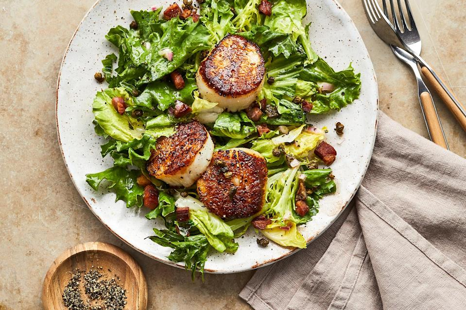 <p>This scallop salad is inspired by the French salad frisée with lardons. Crispy, salty pancetta and fried capers complement the buttery sweet flavor of seared scallops. Softly wilted sturdy greens like frisée or escarole add texture and flavor to this healthy dinner salad.</p>