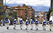 Municipal workers disinfect the streets of La Paz, Bolivia, as a preventive measure to slow the spread of the novel coronavirus, COVID-19