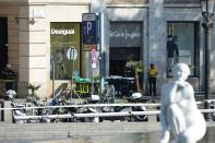 <p>Firefighters stands outside an evacuated mall after a van ploughed into the crowd, injuring several persons on the Rambla in Barcelona on August 17, 2017. (Josep Lago/AFP/Getty Images) </p>