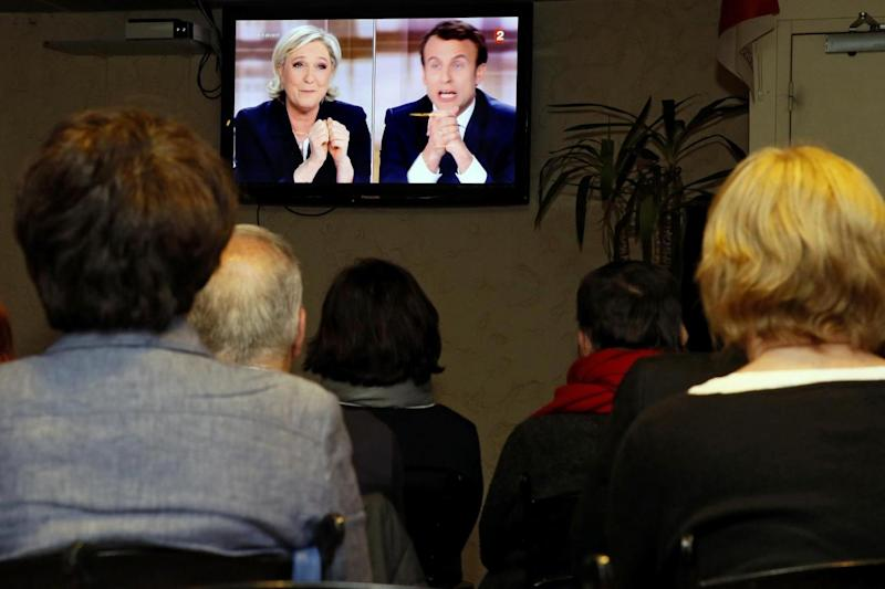 People watch a live broadcast of the debate (AP)
