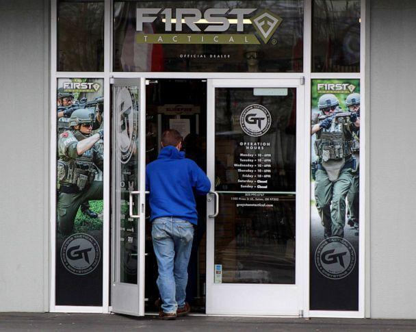 PHOTO: A man enters a gun shop in Salem, Ore, on Feb. 19, 2021, in Salem, Ore. So many guns are being purchased recently that the police are often unable to timely complete background checks, allowing the sales to proceed if the deadline isn't met. (Andrew Selsky/AP)