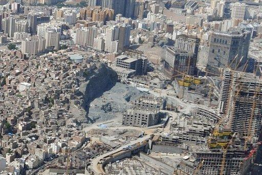Aerial view of the Omar mountain development projects next to a slum area in the holy city of Mecca, Saudi Arabia. The mainly immigrant residents of this slum and other poor neighbourhoods across the city fear authorities will demolish the whole area to give way to modern glitzy developments