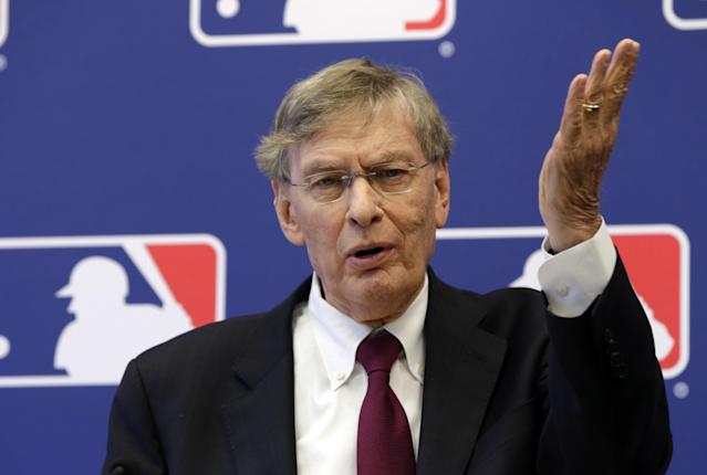 FILE - In this May 16, 2013 file photo, Baseball commissioner Bud Selig answers a question during a news conference at Major League Baseball headquarters, in New York. Selig says the sport's new replay system is working well despite a few problems during its first two weeks. (AP Photo/Richard Drew, File)