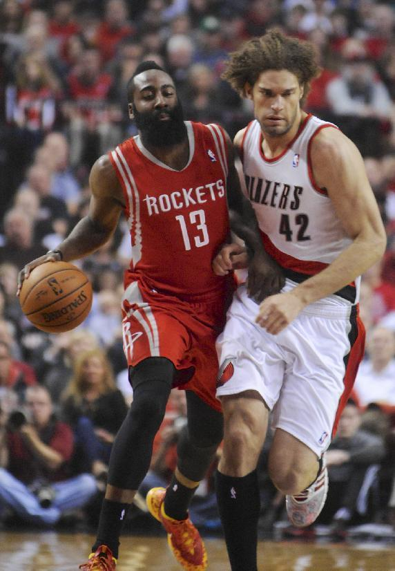 Houston Rockets' James Harden (13) drives against Portland Trail Blazers' Robin Lopez (42) during the first half of game four of an NBA basketball first-round playoff series game in Portland, Ore., Sunday March 30, 2014. (AP Photo/Greg Wahl-Stephens)