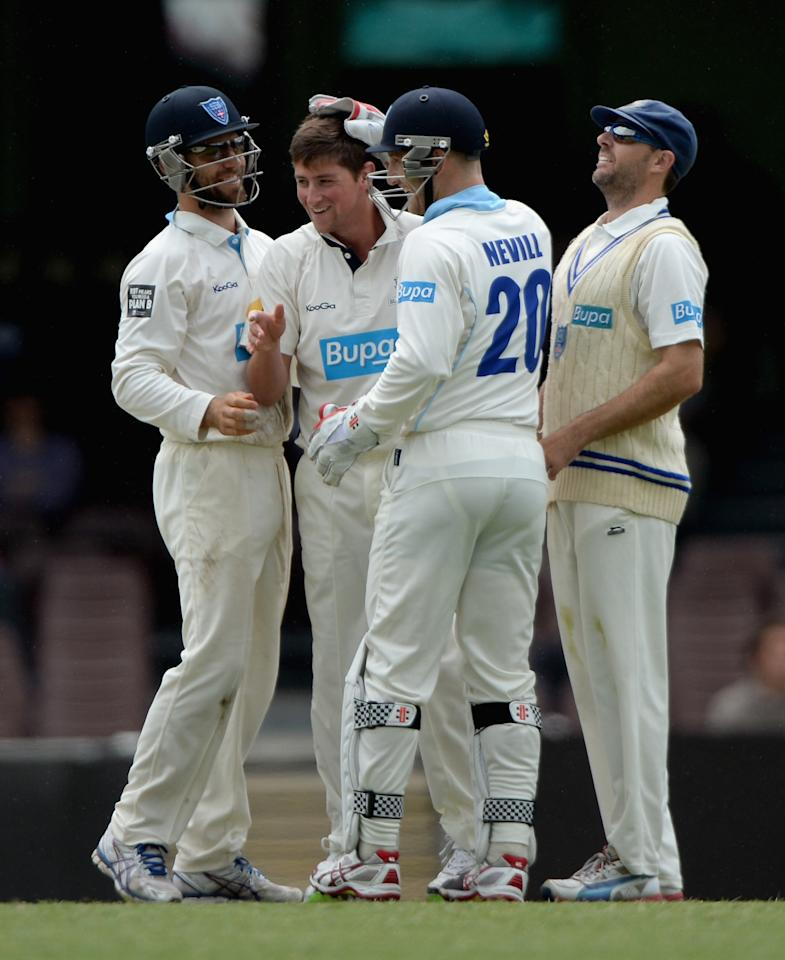 SYDNEY, AUSTRALIA - NOVEMBER 16:  James Muirhead of CA Invitational XI celebrates with teammates after dismissing England captain Alastair Cook during day four of the tour match between CA Invitational XI and England at the Sydney Cricket Ground on November 16, 2013 in Sydney, Australia.  (Photo by Gareth Copley/Getty Images)