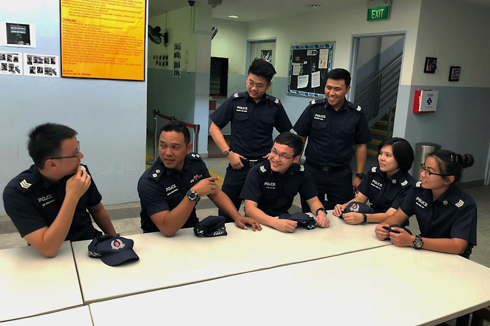 (L-R) Sgt Lee Zheng Biao, Inspector Ishak Mohali, Sgt Chong Zhe Ming, Sgt Caleb Kok, Sgt Desmond Heng, Sgt Sharon Ang and Sgt Eunice Sam are among the officers who helped apprehend a suspect from Rochor Canal, posing for photos on Tuesday, 2 October 2018. PHOTO: Nicholas Yong/Yahoo News Singapore