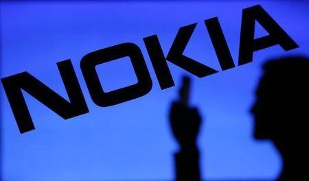 A photo illustration of a man silhouetted against a Nokia logo
