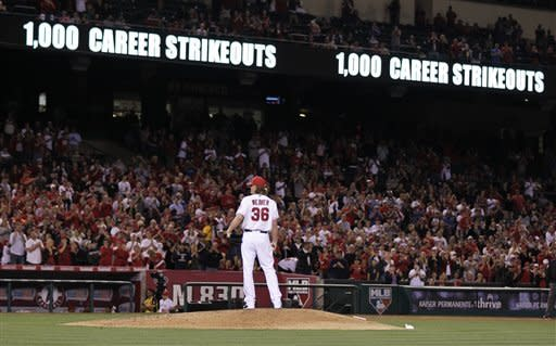 Los Angeles Angels starting pitcher Jered Weaver stand on the mound after his 1,000th career strikeout, during the sixth inning of a baseball game against the Oakland Athletics in Anaheim, Calif., Monday, April 16, 2012. (AP Photo/Chris Carlson)