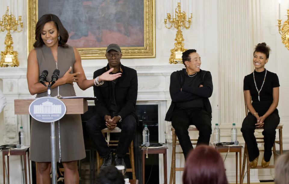 <p>In the presence of impressive musicians as well as 60 middle school students, the first lady managed to be both cool and professional with by wearing a conservatively cut shift dress with a zipper down the front. </p>