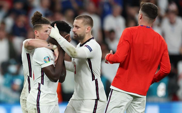 Bukayo Saka is consoled by Kalvin Phillips and Luke Shaw after the team's fifth penalty was saved - Eddie Keogh - The FA/The FA via Getty Images