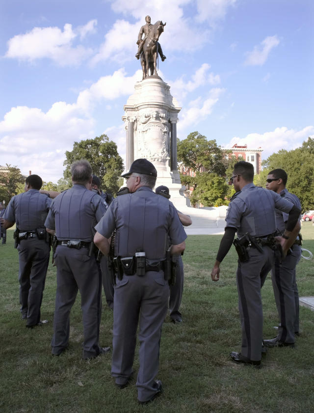 <p>Capitol Police officers are posted around the statue of Confederate Gen. Robert E. Lee Friday, Aug. 18, 2017 in Richmond, Va. Virginia Governor Terry McAuliffe signed an executive order banning any demonstrations at the Lee Monument. (Photo: Bob Brown/Richmond Times-Dispatch via AP) </p>