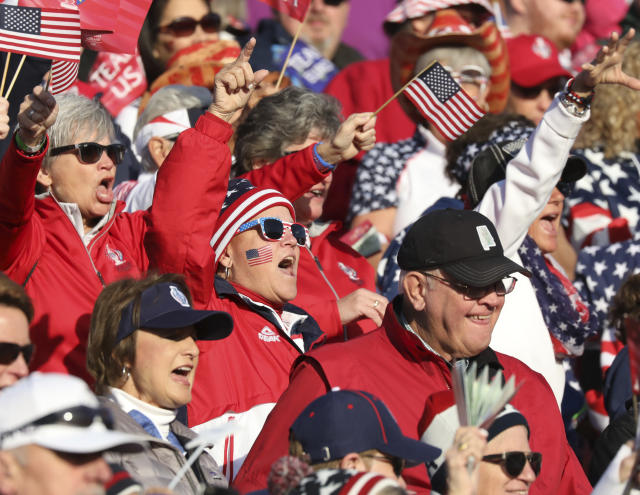 Golf fans cheers on their teams in the Solheim cup at Gleneagles, Auchterarder, Scotland, Friday, Sept. 13, 2019. (AP Photo/Peter Morrison)