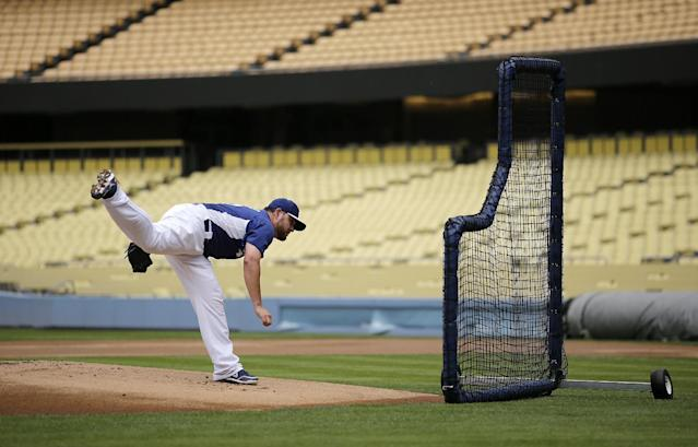 Los Angeles Dodgers starting pitcher Ricky Nolasco throws the ball during practice in preparation for Friday's Game 1 of the National League baseball championship series, Wednesday, Oct. 9, 2013, in Los Angeles. The Dodgers will face the winner of the series between the St. Louis Cardinals and the Pittsburgh Pirates. (AP Photo/Jae C. Hong)