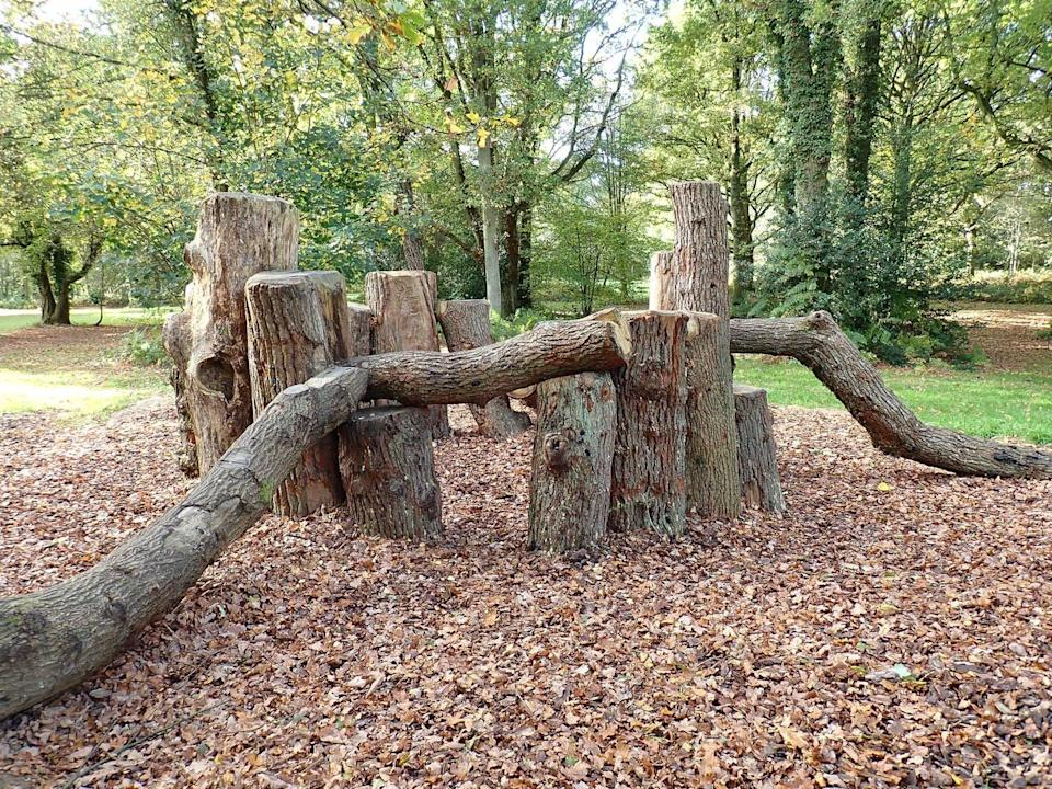 A natural playground built of logs.