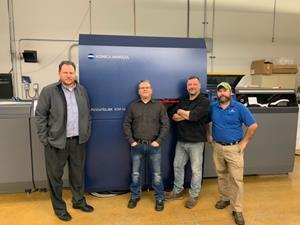 The Vomela Companies recently installed Konica Minolta's AccurioJet KM-1e LED UV Inkjet Press at its Elk Grove, IL production location. L-R: Glen Hoffmann, General Manager; Todd Mason, Director of Operations; Jim Munoz, KM-1e Operator; Chris Snyder, KM-1e Operator