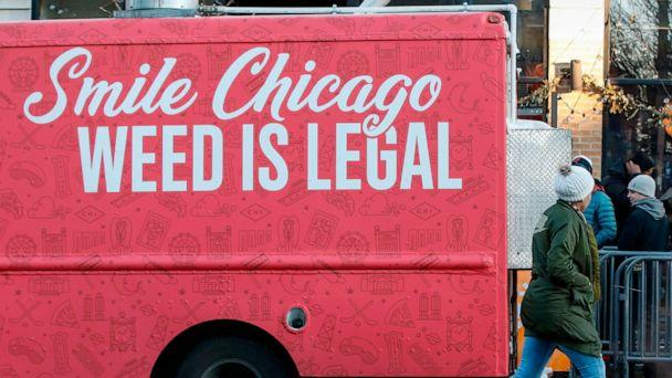 PHOTO: A food truck sits outside the Sunnyside Cannabis Dispensary as customers wait in line to buy marijuana, on Jan. 1, 2020 in Chicago. On the first day of 2020, recreational marijuana  became legal in Illinois. (Kamil Krzaczynski/AFP via Getty Images)