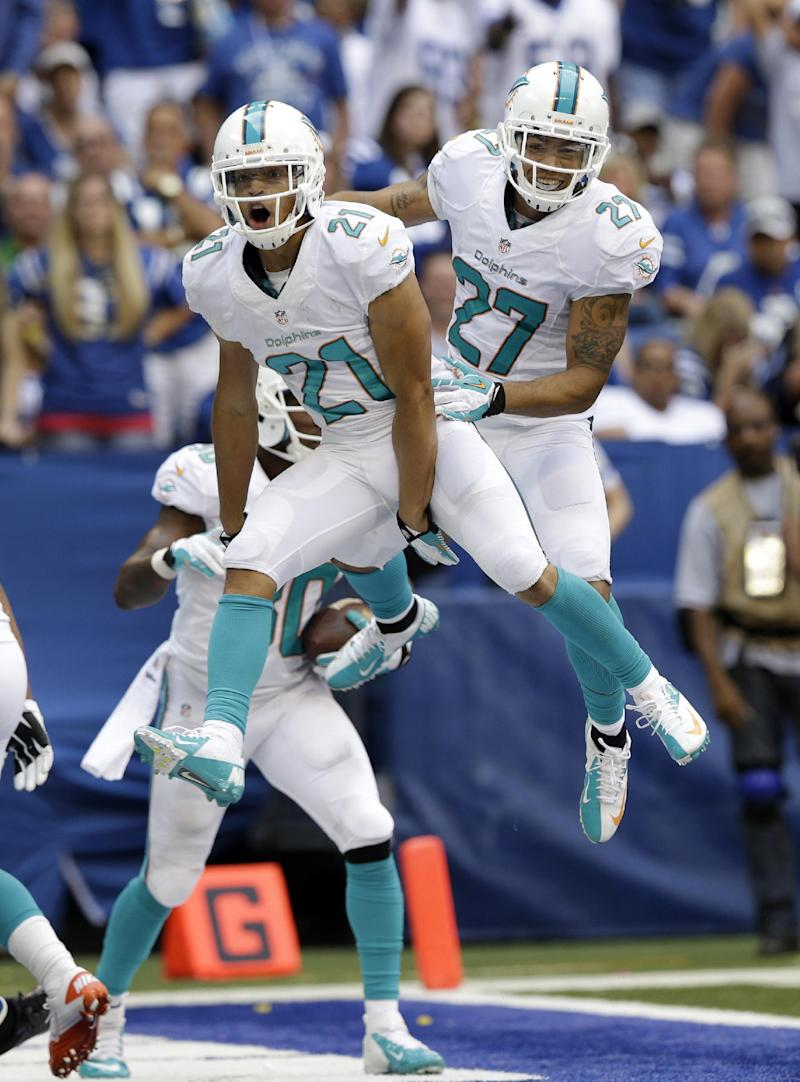 Dolphins stop Indy comeback, hold on for 24-20 win