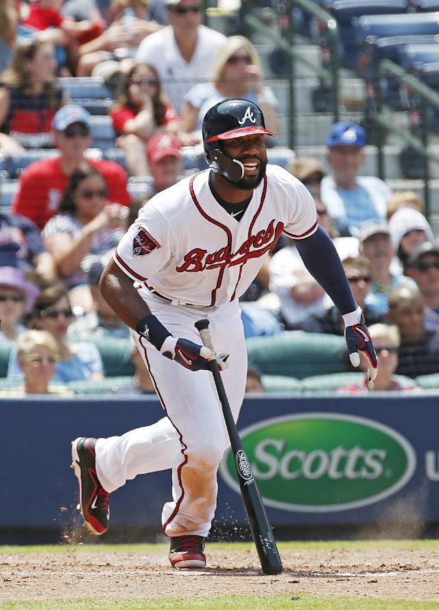 Atlanta Braves right fielder Jason Heyward (22) reacts as he grounds out in the eighth inning of a baseball game against the Seattle Mariners Wednesday, June 4, 2014 in Atlanta. Seattle won 2-0. (AP Photo/John Bazemore)