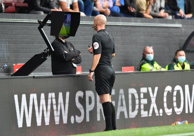 Referee Anthony Taylor changed his penalty decision after viewing the pitch-side VAR screen at Turf Moor