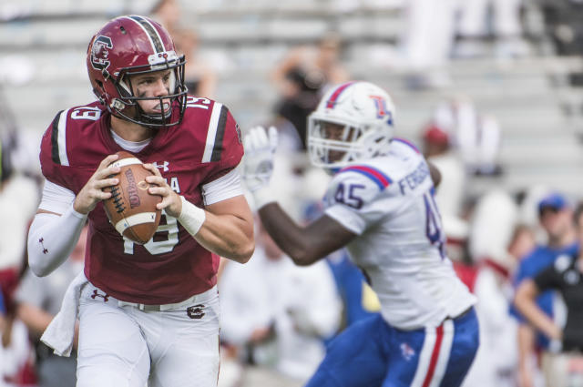 "South Carolina quarterback <a class=""link rapid-noclick-resp"" href=""/ncaaf/players/269283/"" data-ylk=""slk:Jake Bentley"">Jake Bentley</a> (19) looks for an open teammate against Louisiana Tech defensive end <a class=""link rapid-noclick-resp"" href=""/ncaaf/players/239562/"" data-ylk=""slk:Jaylon Ferguson"">Jaylon Ferguson</a> (45) during the first half of an NCAA college football game Saturday, Sept. 23, 2017, in Columbia, S.C. (AP Photo/Sean Rayford)"