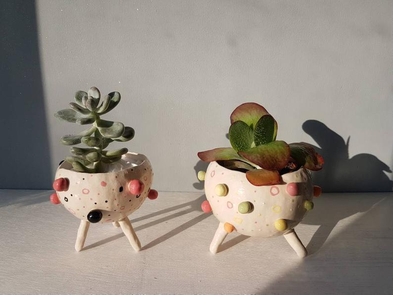 """<strong>Under £50</strong><br><br>Getting my pot collection to catch up with my lockdown plant collection is gonna be tough but I'm obsessed with Etsy ceramicist Xin's pots. Her bobbly pot collection is my fave but there's all sorts of weird and wonderful creations on her page to check out.<br><br><strong>HiThereTheShop</strong> The Bobbly Pot Collection, $, available at <a href=""""https://www.etsy.com/uk/listing/582217150/the-bobbly-pot-collection-ceramic?ref=shop_home_active_41&frs=1&sca=1"""" rel=""""nofollow noopener"""" target=""""_blank"""" data-ylk=""""slk:Etsy"""" class=""""link rapid-noclick-resp"""">Etsy</a>"""