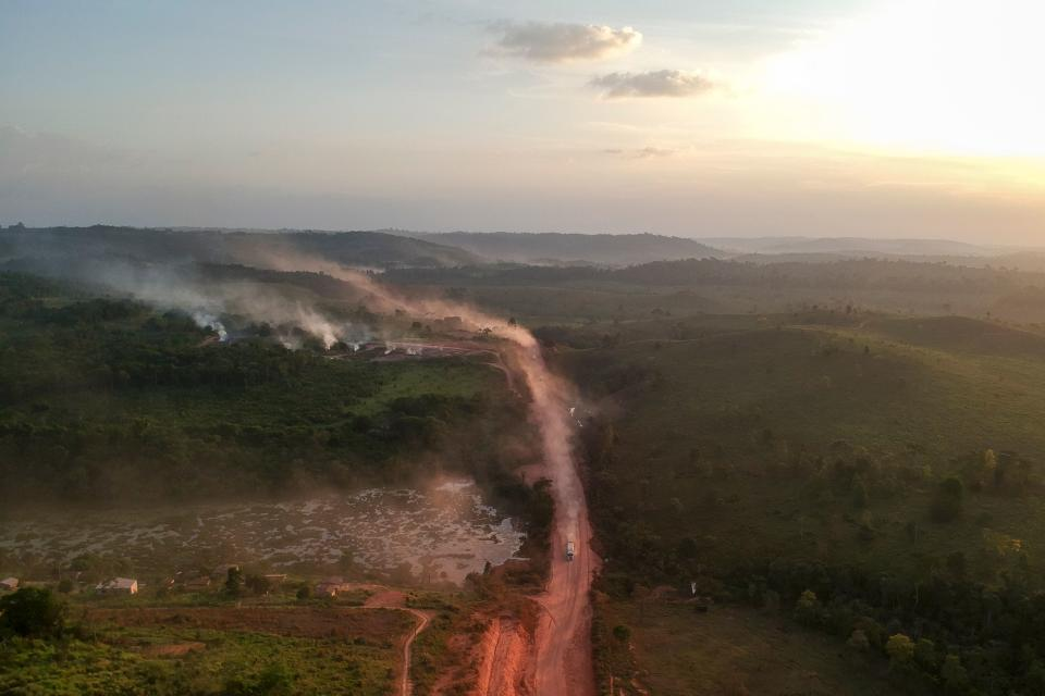 """TOPSHOT - In this aerial view the red dust of the BR230 highway, known as """"Transamazonica"""", mixes with fires at sunset in the agriculture town of Ruropolis, Para state, northen Brazil, on September 6, 2019. - Presidents and ministers from seven Amazon countries met in Colombia on Friday to agree on  measures to protect the world's biggest rainforest, under threat from wildfires and rampant deforestation. The summit took place in the wake of an international outcry over months of raging fires that have devastated swaths of the Amazon in Brazil and Bolivia. (Photo by Johannes MYBURGH / AFP)        (Photo credit should read JOHANNES MYBURGH/AFP/Getty Images)"""