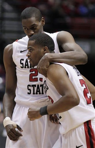San Diego State's Jamaal Franklin, above, embraces Chase Tapley during the second half of an NCAA college basketball game against Chicago State, Tuesday, Jan. 10, 2012, in San Diego. (AP Photo/Gregory Bull)