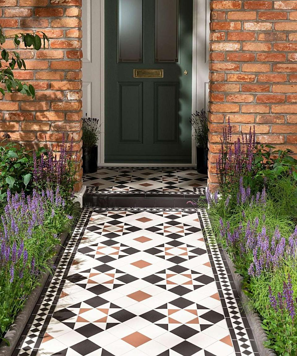 Victorian style paved pathway leading to a front door
