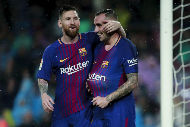 "Paco Alcacer (R) and <a class=""link rapid-noclick-resp"" href=""/soccer/players/lionel-messi/"" data-ylk=""slk:Lionel Messi"">Lionel Messi</a> celebrate one of Alcacer's two goals in <a class=""link rapid-noclick-resp"" href=""/soccer/teams/barcelona/"" data-ylk=""slk:Barcelona"">Barcelona</a>'s match vs. <a class=""link rapid-noclick-resp"" href=""/soccer/teams/sevilla/"" data-ylk=""slk:Sevilla"">Sevilla</a>. (Getty)"