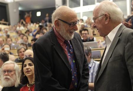 British physicist Peter Higgs shakes hands with Belgium physicist Francois Englert before a scientific seminar in Meyrin