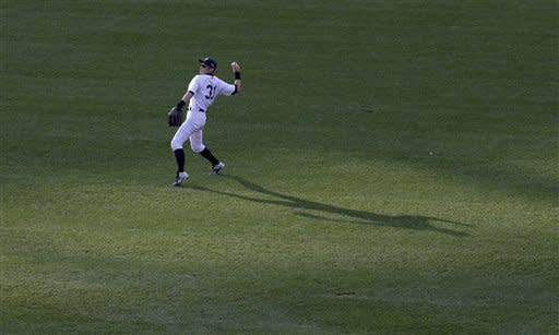 New York Yankees' outfielder Ichiro Suzuki warms up before the third inning of Game 2 of the American League championship series against the Detroit Tigers Sunday, Oct. 14, 2012, in New York. (AP Photo/Charlie Riedel)