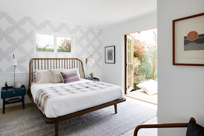 """AFTER: """"I love how balanced the overall design, look, and vibe is and how it translates so well to our modern farmhouse theme. The home feels complete and the rooms have their own unique personalities, which tie in nicely with the rest of the property,"""" Shanty says of the bedroom."""
