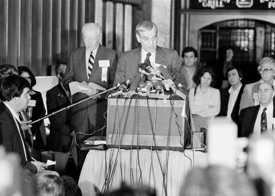F. Don Miller, at microphones, executive director of the U.S. Olympic Committee, reads a resolution that was adopted by the U.S. Olympic Committee's House of Delegates on a boycott of the 1980 Summer Games in Moscow by the U.S. Olympic team, in Colorado Springs, Colo., April 12, 1980. At left is Robert Kane, president of the U.S. Olympic Committee. (AP Photo/Ed Andrieski)