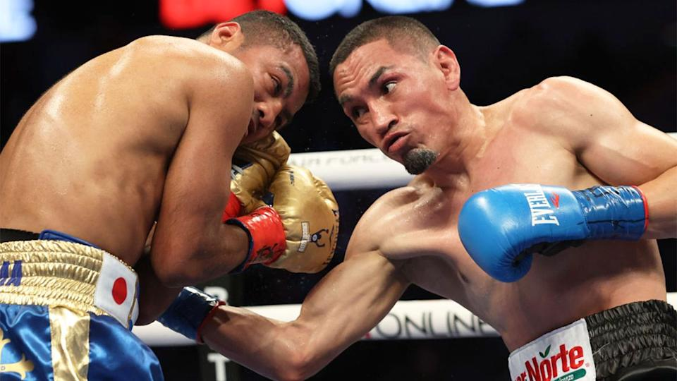 Pictured here, Juan Francisco Estrada punches Roman 'Chocolatito' Gonzalez during their bout.