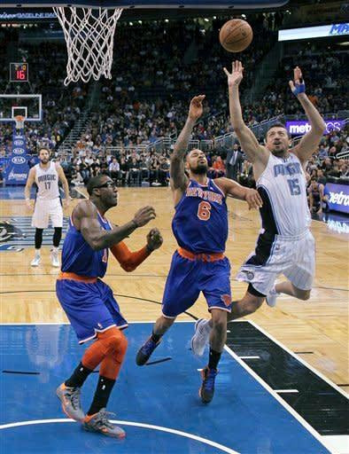 Orlando Magic's Hedo Turkoglu (15), of Turkey, takes a shot over New York Knicks' Tyson Chandler (6) and Amare Stoudemire, left, during the first half of an NBA basketball game, Saturday, Jan. 5, 2013, in Orlando, Fla. (AP Photo/John Raoux)