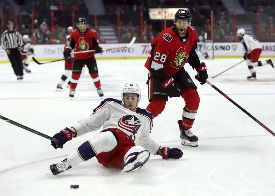 Ottawa Senators right wing Connor Brown (28) reacts to being given a holding penalty against Columbus Blue Jackets centre Pierre-Luc Dubois (18) during the first period of an NHL hockey game in Ottawa, Saturday, Dec. 14, 2019. (Fred Chartrand/The Canadian Press via AP)