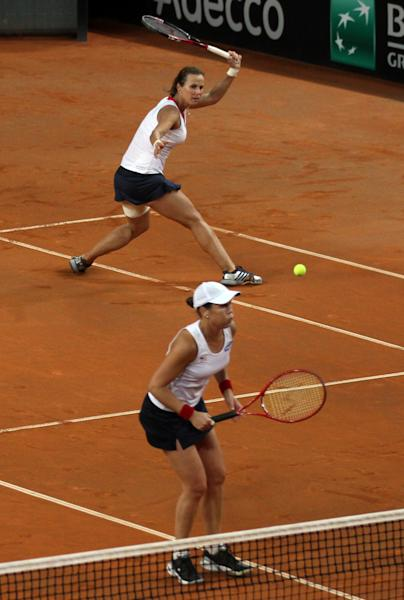 United States' Varvara Lepchenko, top, and Liezel Huber play Italy's Sara Errani and Roberta Vinci during a World Group first round Fed Cup tennis double match at the 105 stadium in Rimini, Italy, Sunday, Feb. 10, 2013. (AP Photo/Felice Calabro')