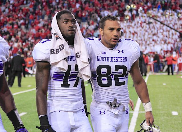 Northwestern wide receiver Rashad Lawrence (17) and Northwestern wide receiver Andrew Scanlan (82) walk off the field following a 27-24 loss to Nebraska in an NCAA college football game in Lincoln, Neb., Saturday, Nov. 2, 2013. (AP Photo/Nati Harnik)