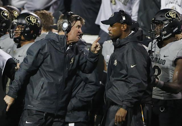 FILE – In this Oct. 3, 2015, file photo, Colorado head coach Mike MacIntyre, left, has heated words with assistant coach Joe Tumpkin during a game against Oregon. (AP Photo/Brennan Linsley, File)