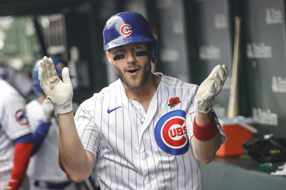 May 31, 2021; Chicago, Illinois, USA; Chicago Cubs third baseman Patrick Wisdom (16) celebrates after hitting a solo home run against the San Diego Padres during the fourth inning at Wrigley Field. Mandatory Credit: Kamil Krzaczynski-USA TODAY Sports