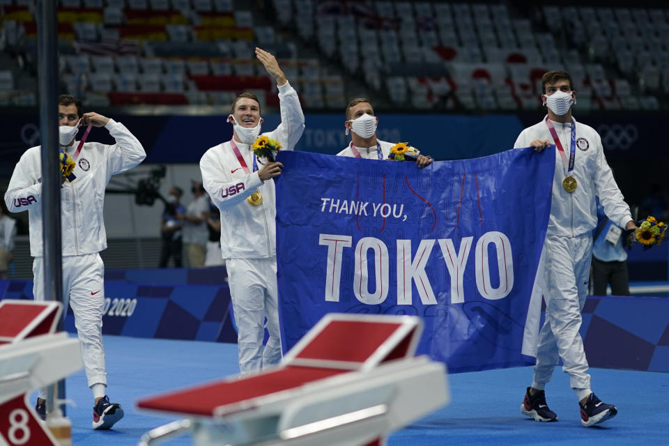 The United States' men's 4x100-meter medley relay team, Caeleb Dressel, Zach Apple, Ryan Murphy and Michael Andrew, celebrate after winning the gold medal at the 2020 Summer Olympics, Sunday, Aug. 1, 2021, in Tokyo, Japan. (AP Photo/David Goldman)